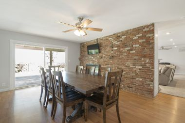 Spacious formal dining room for large family gatherings. Note the fireplace and slider to the backyard.
