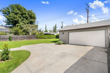 2-car garage with workshop and extra parking for turnaround so you don't have to back out onto Magnolia Avenue.