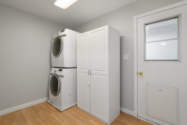 Separate indoor laundry room with space for cabinetry, shelving, and even side-by-side units.