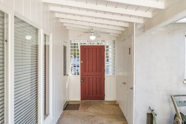 Dutch door entrance from the front yard into the courtyard