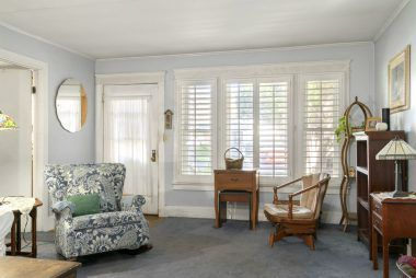 Front entrance with plantation shutters and double pane windows.