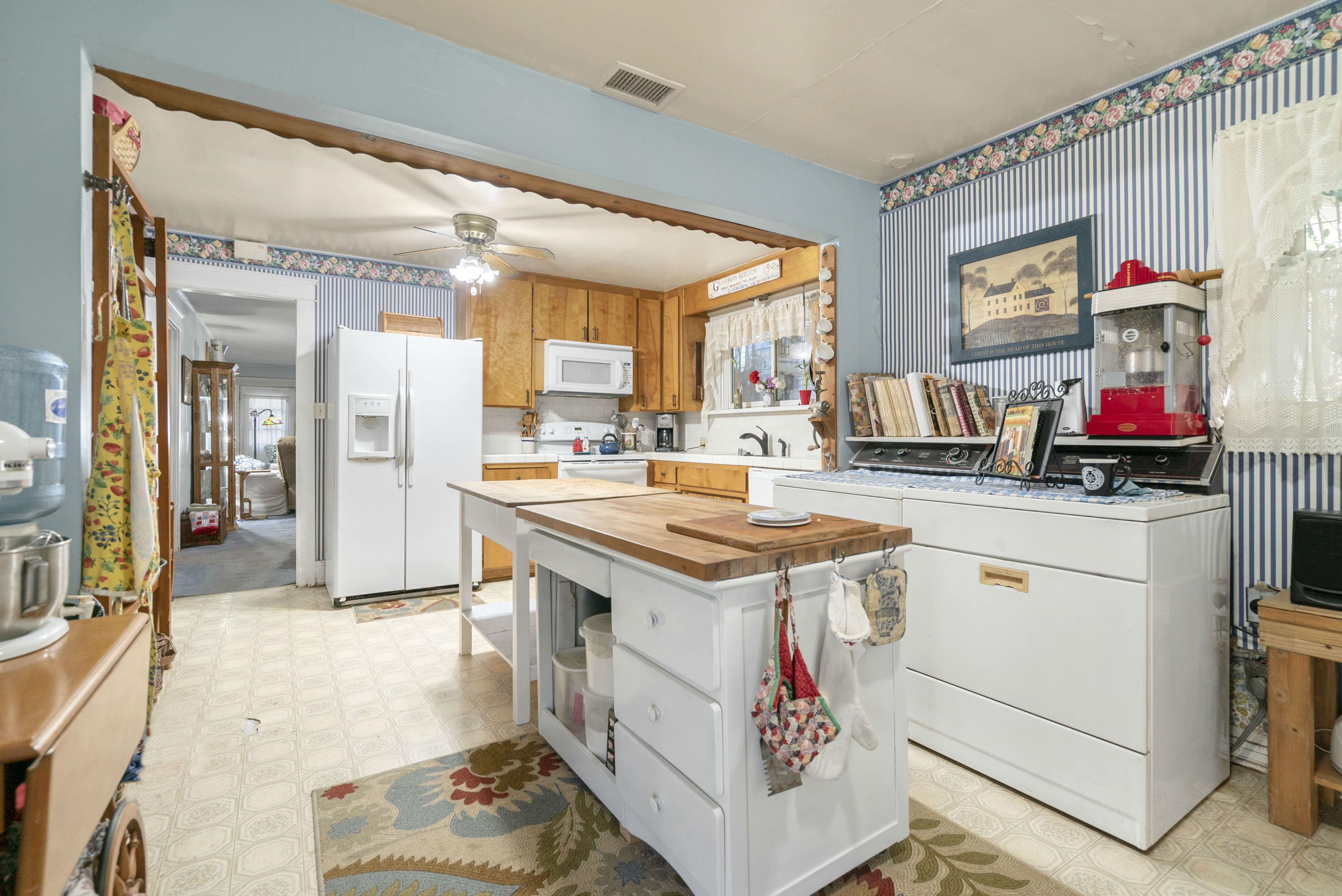 Large kitchen with laundry area, pantry, and space for preparation islands.