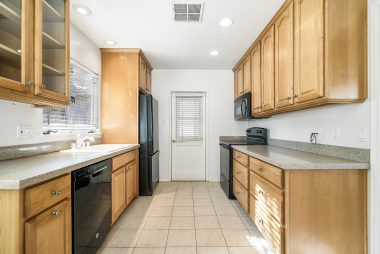 Updated kitchen with matching appliances, which are included (dishwasher, refrigerator, built-in microwave, and stove).