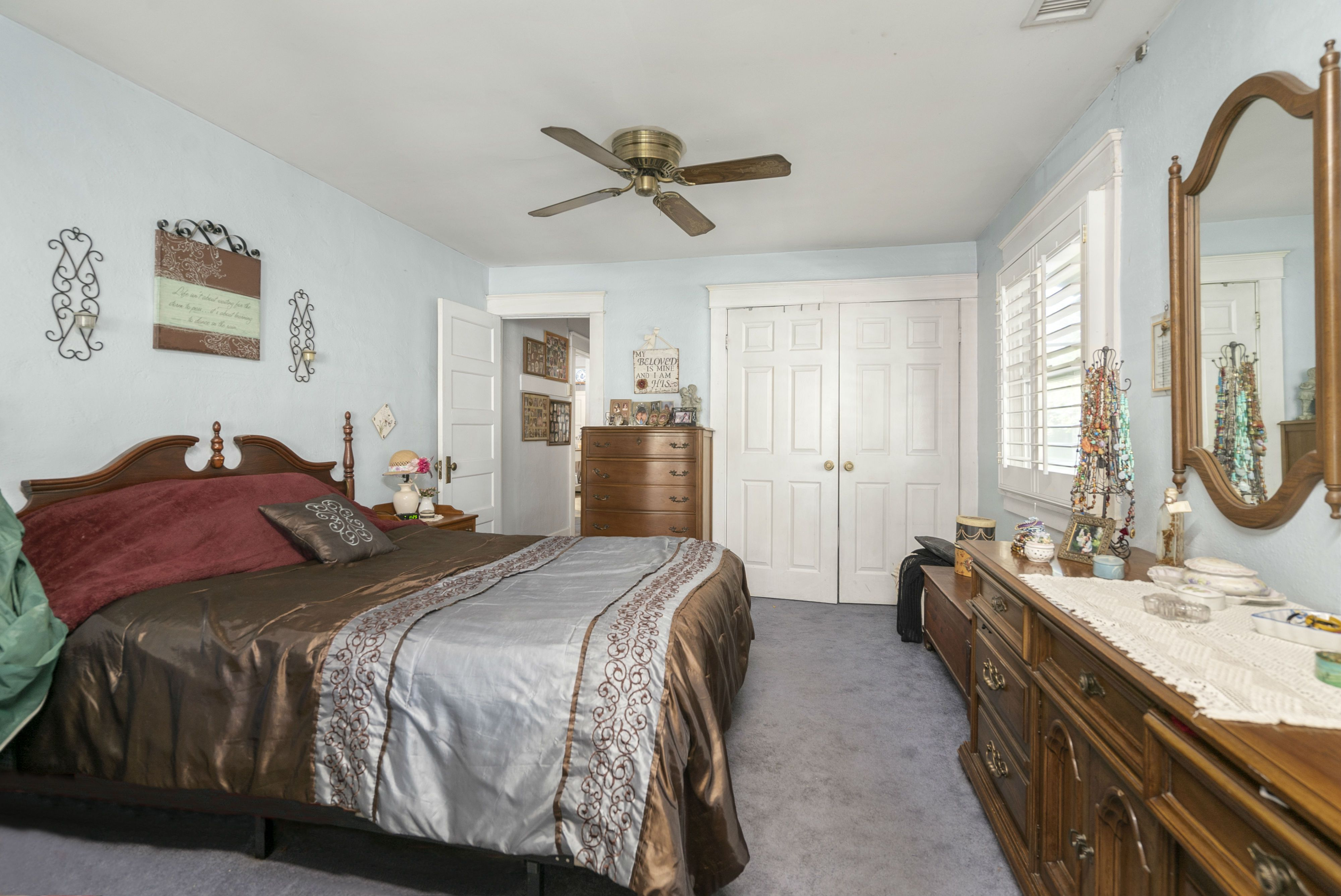 Alternate view of front bedroom with large closet and door to the hallway and remodeled bathroom.