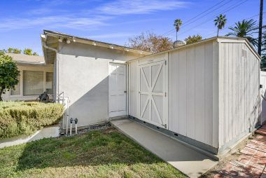 Large shed attached to the garage (ideal for extra lawn storage items or bicycles, or could be used as an office or gym.