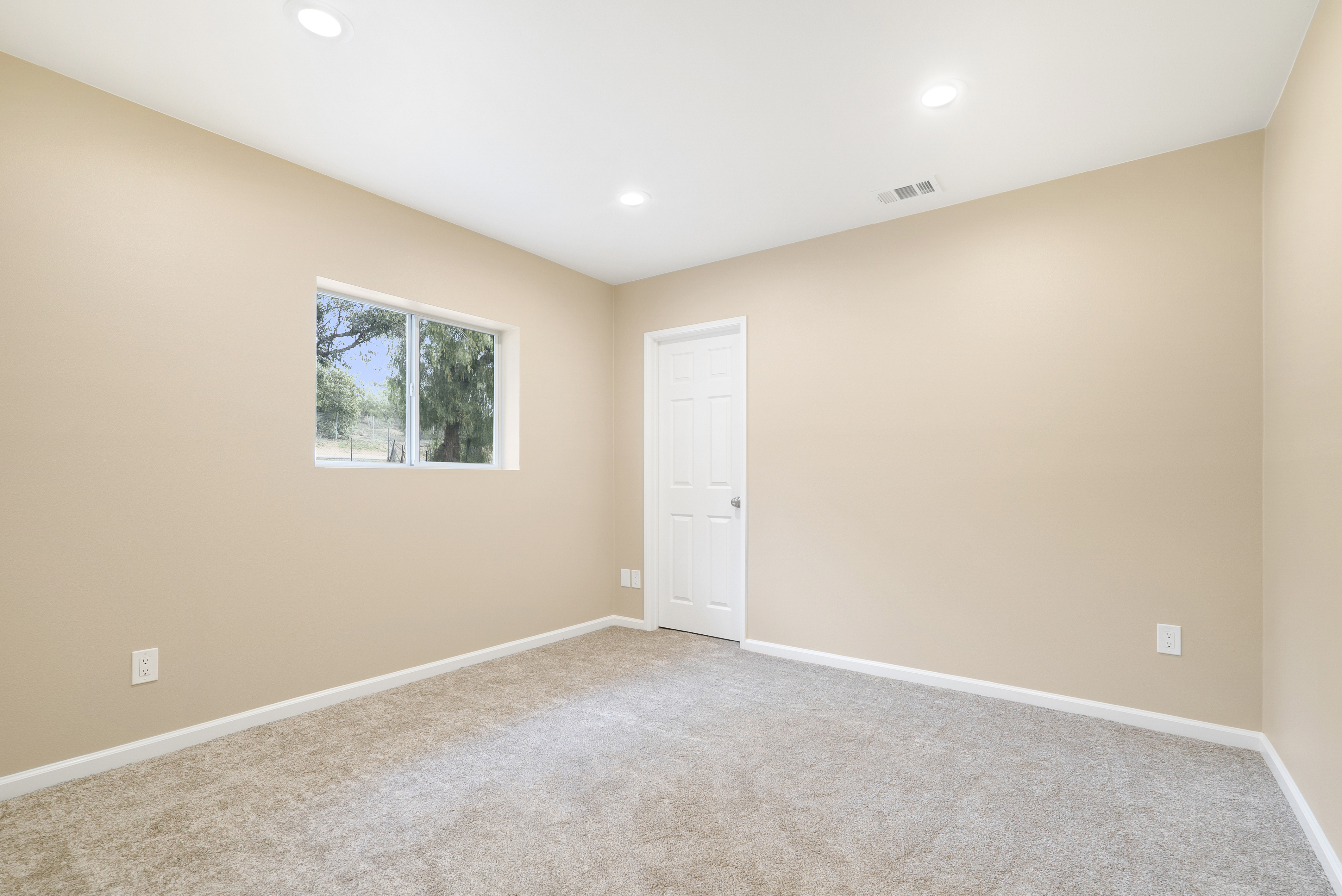 Back bedroom with new carpet, new paint, new recessed lighting, double pane window, and its own walk-in closet!
