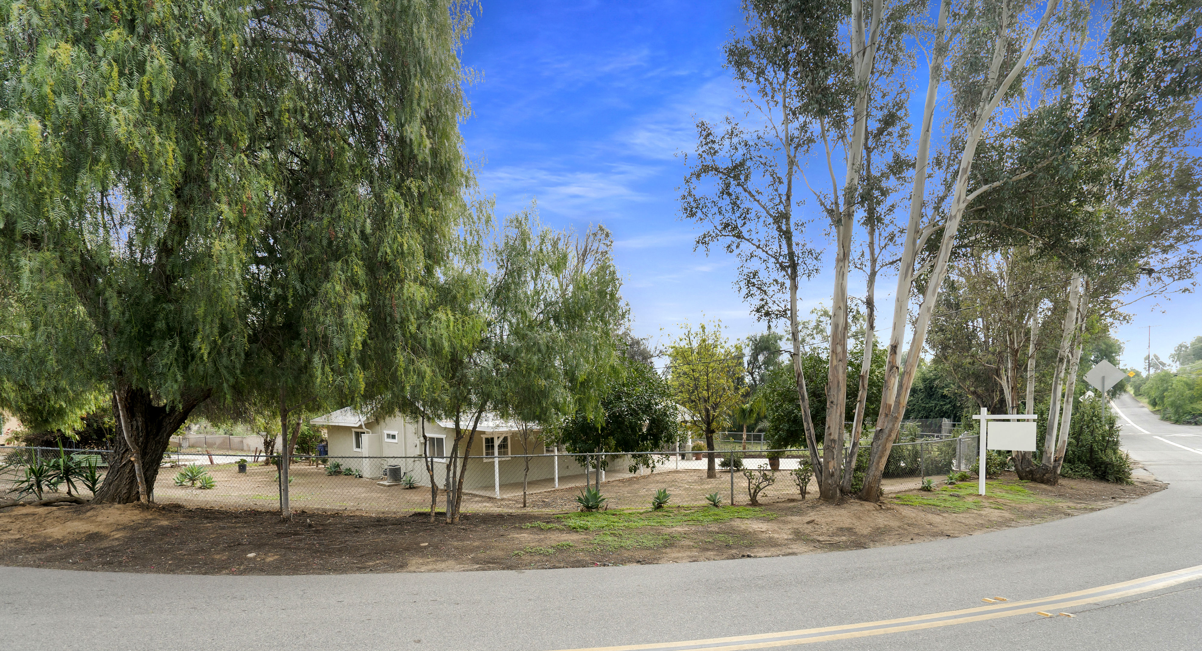 View of the entire property (lot size is 13,068 sq ft) -- just over a quarter acre, and completely fenced!