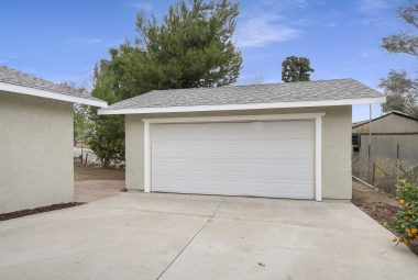 In addition to the carport, enjoy a detached full 2-car size garage that is only 15 yrs old, with a roll up door too.