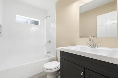 Fully remodeled bathroom. Brand new tub, new tile surround, new flooring, new vanity, new paint, new toilet. ALL NEW!