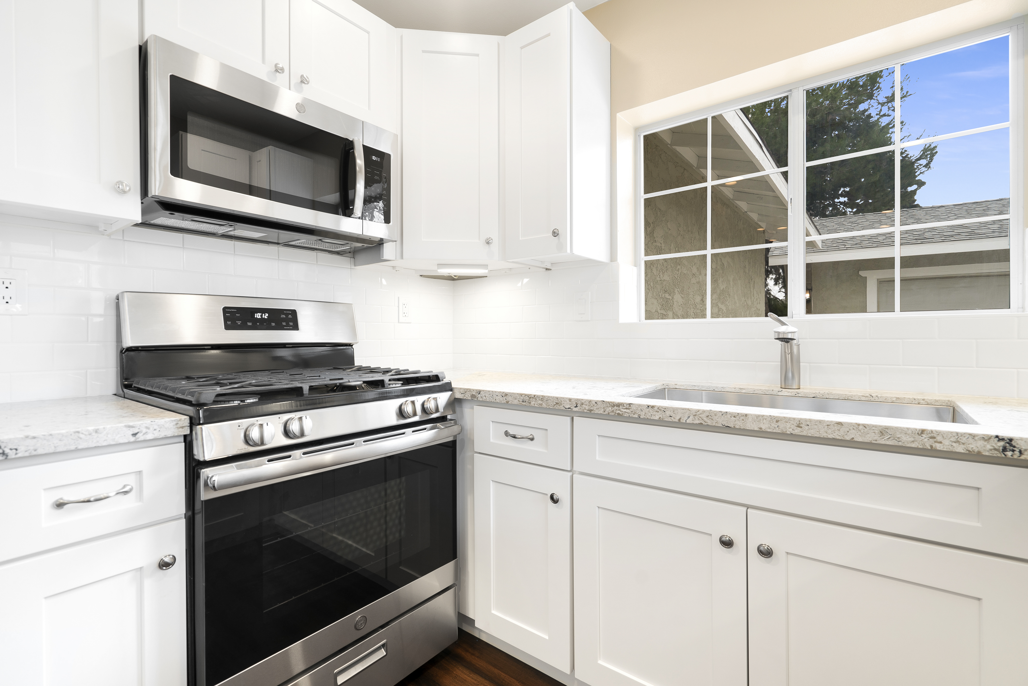 BRAND NEW gas stove and built-in microwave, as well as brand new dishwasher too.