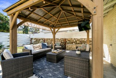 Lovely and spacious gazebo (which stays with the property) next to the garage, complete with electricity for TV viewing and entertaining throughout the year, day or night.