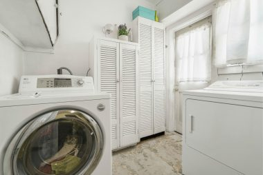Indoor laundry with gas hookup for clothes dryer.