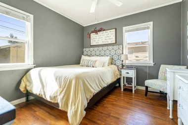 """One of three bedrooms, with ceiling fan and a """"Wood Streets"""" walk-in closet."""
