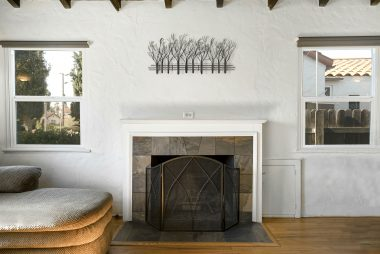 Fireplace is the centerpiece of this lovely room.