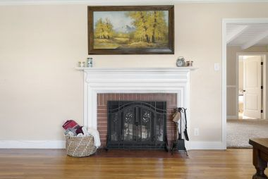 Wood burning fireplace in the living room.