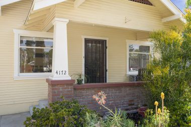 Breezy front porch and professional water-wise landscaping.
