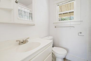 GUEST HOUSE full bathroom with shower in tub, and new toilet.