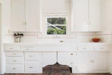 Tile counters and quaint back splash.