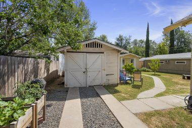 """Main house garage (being sold """"as is""""). Hollywood driveway off of Edgewood with potential RV/parking as well."""