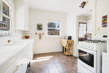 Bright and sunny kitchen with gas stove and refrigerator (both included).