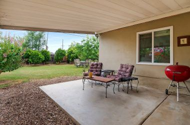 Large covered patio not only keeps the sun off the house, but off your guests as well.