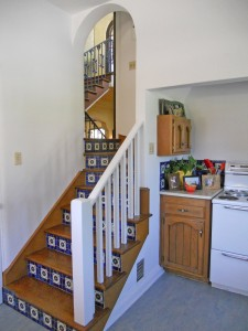Kitchen stairs that lead to the foyer staircase. The kitchen is spacious with an antique stove, new dishwasher, walk-in pantry, and lots of cabinetry.