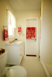 Second remodeled bathroom with shower, newer vanity, and built-in linen cabinet.