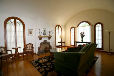 Barrel ceiling in living room makes this room feel even larger than it is. Arched windows bring the whole Mediterranean-influenced style together!