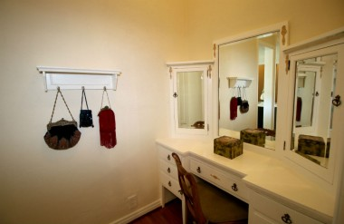 Walk-thru closet with built-in makeup desk and lots of closet space.