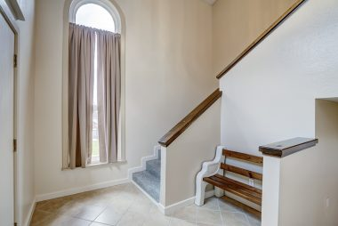 Alternate view of foyer. Stairs going down to the right lead you to the huge bonus room, an additional bedroom and bathroom, and garage access.