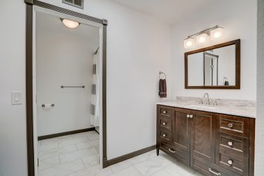 Brand new remodeled bathroom with tile floor, two separate vanities, and a soaking tub.