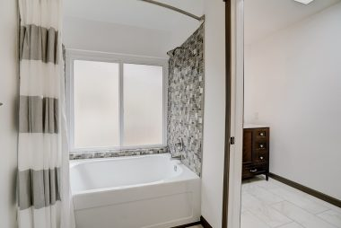 Brand new soaking tub is so new that is has never been used. Gorgeous wall tile.
