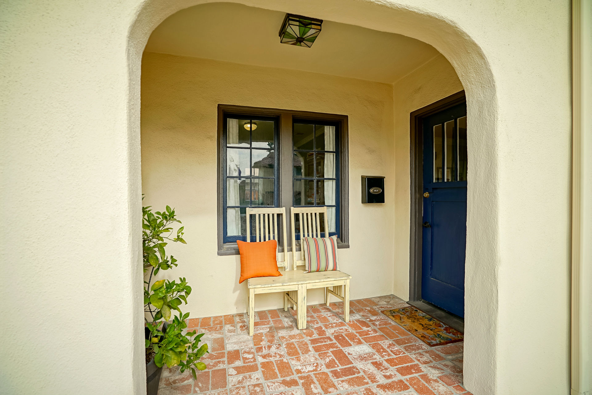 Adorable covered front entry.