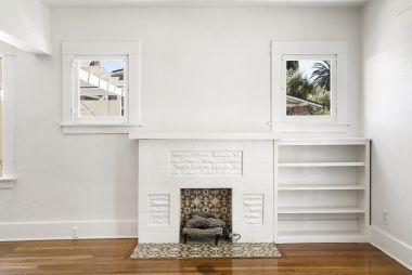 Gas fireplace with built-in display shelves.