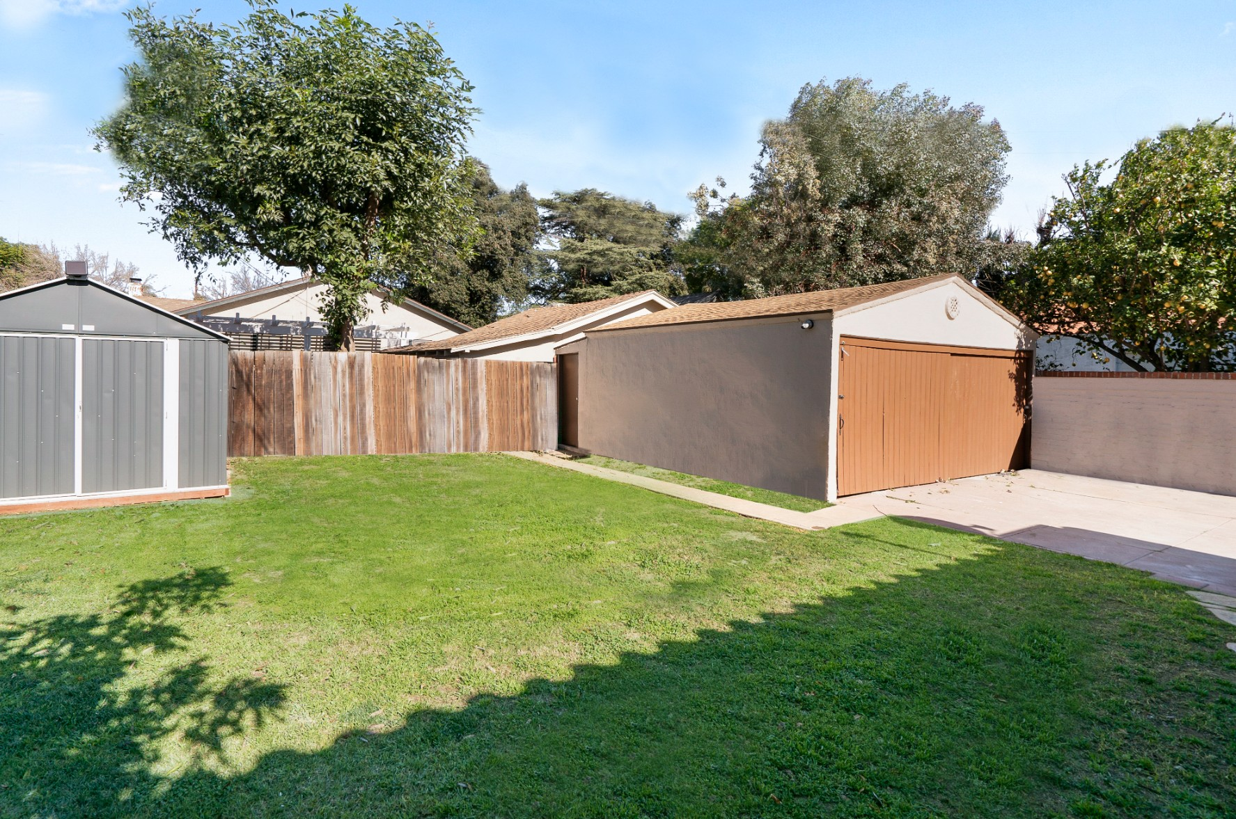 Back yard with shed and 2-car garage with utility room off the back for extra tools or more storage