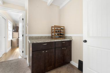 Extra cabinet space or bar area, with view into the master bedroom, which is on the opposite side of the home than the secondary bedrooms.