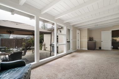 Alternate view of the family room with view out onto the back patio.
