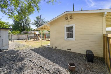 Completely fenced back yard of guest house with extra area for parking or future patio area.