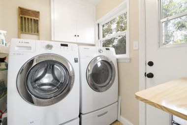 Separate indoor laundry room off the kitchen, and washer/dryer convey with sale.