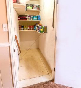 Pantry with pull-up trap door which leads to the garage and basement (see next photo with pull-up door in open position).