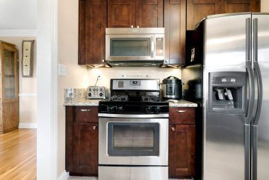 Stainless steel gas stove and built-in microwave, with granite counter top.