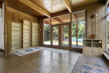 Alternate view of family room, with even more storage cabinets and shelving on another wall.