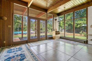 Incredibly charming family room overlooking the amazing back yard.