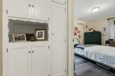 Hallway linen closet with peekaboo view into Bedroom #3