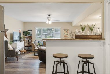 View of breakfast bar into the step-down family room.