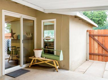 Double pane windows throughout, with a double pane slider too, from the kitchen out to the covered patio. New redwood gate leads to the side yard.