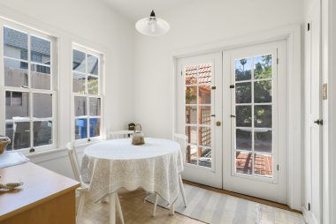 Truly bright and sunny breakfast nook off the kitchen, with French doors leading to the back yard.