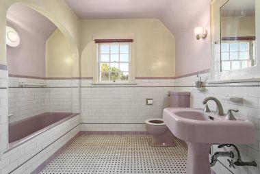 Upstairs hallway bathroom shared between bedrooms #1 and #2, with original basket weave tile flooring, original violet pedestal sink, toilet and tub. Out of view is a separate shower stall.